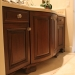 Distressed Alder Radius Bathroom Cabinet Photo